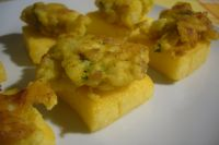 Deep fried cauliflower on polenta croutons