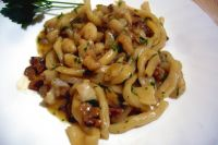Pasta with monkfish and mushrooms