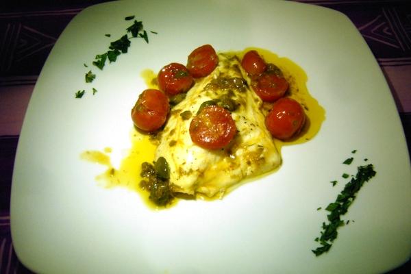 Fish, here a fillet of sea bream, all & # 039; Acqua Pazza