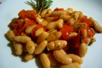 Garnish with cannellini beans and cherry tomatoes