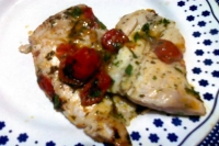 Fillets of plaice with cherry tomatoes datterini