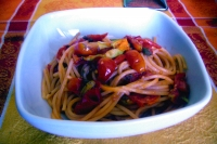 Spaghetti tomatoes, capers and pumpkin flowers